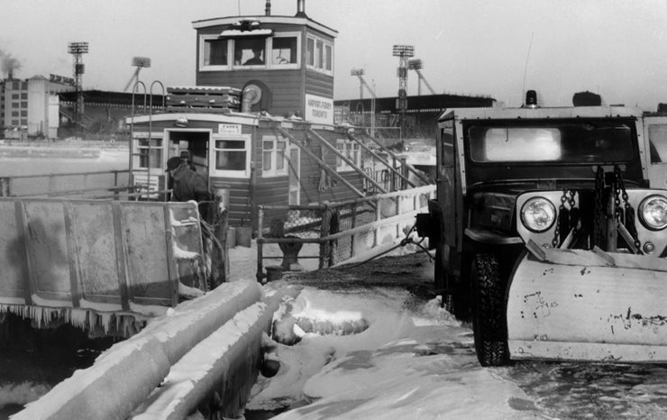 Tug boat at dock in winter