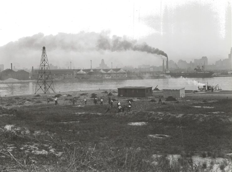 Work beginning on the site of the airport with city in background