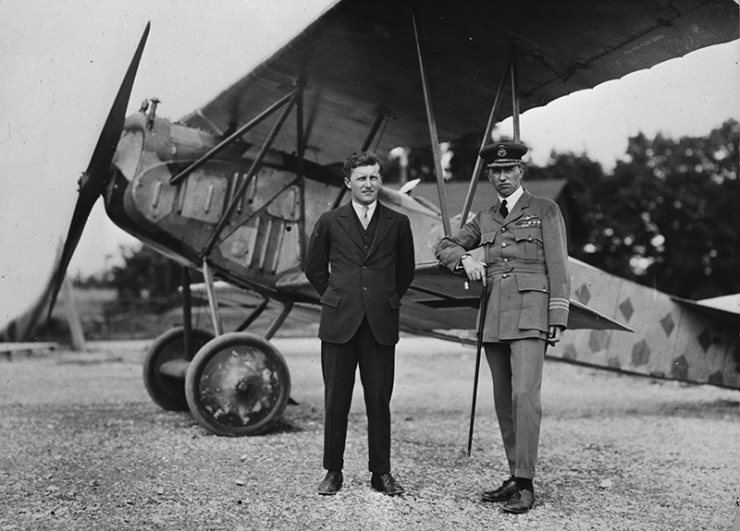 Billy Bishop standing infront of fighter plan