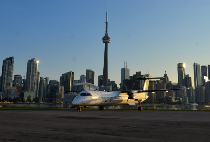 Porter airline plane on the runway with downtown Toronto in the background