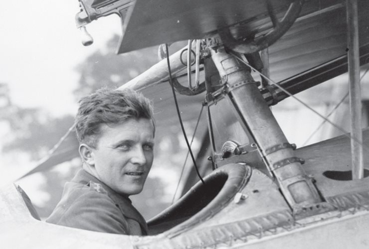 Billy Bishop in a plane cockpit, closeup