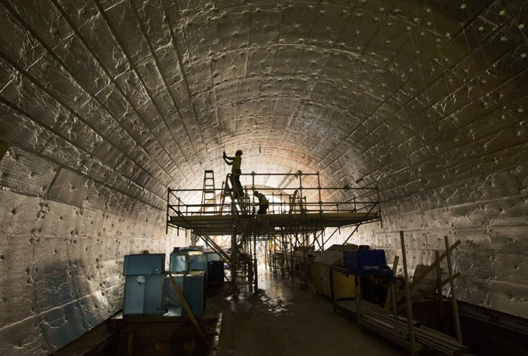 Tunnel with workers on ceiling